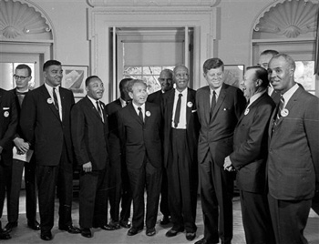 In this Aug. 28, 1963 file photo, President Kennedy stands with a group of leaders of the March on Washington at the White House in Washington. Immediately after the march, they discussed civil rights legislation that was finally inching through Congress.