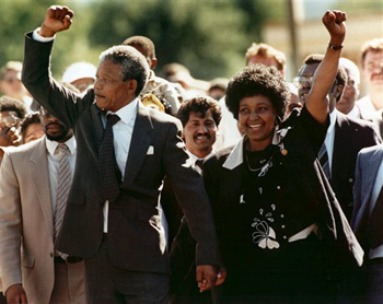 In this Feb. 11, 1990, file photo, Nelson Mandela and his wife, Winnie, raise clenched fists as they walk hand-in-hand upon his release from prison in Cape Town, South Africa. South Africa's president says, Thursday, Dec. 5, 2013, that Mandela has died. He was 95.