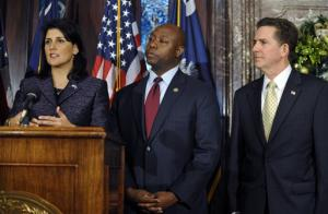 South Carolina Gov. Nikki Haley, left. U.S. Rep Tim Scott, center. U.S. senator as Sen. Jim DeMint, right.