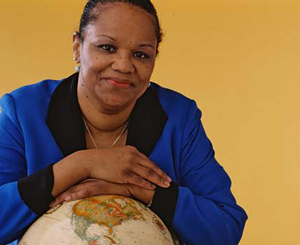 An African-American woman and a globe