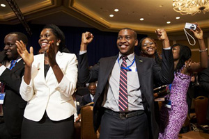 Attendees of the Summit of the Washington Fellowship for Young African Leaders cheer as President Barack Obama announces that the program will be renamed in honor of former South African President Nelson Mandela, Monday, July 28, 2014, in Washington. The summit is the lead-up event to next week's inaugural U.S.-Africa Leaders Summit, the largest gathering any U.S. President has held with African heads of state.