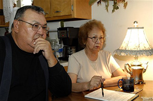 In this Nov. 10, 2009 file photo, George and Marilyn Keepseagle talk about the lawsuit, at their kitchen table, in Fort Yates, N.D. American Indian groups are fighting a plan to create a charitable foundation with almost $400 million in federal dollars left over from a 2010 government discrimination settlement. A federal judge will review the matter Tuesday.