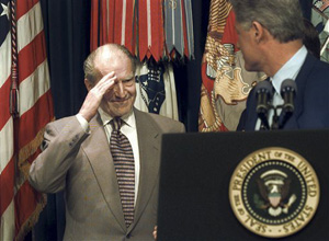 In this May 28, 1996 file photo, retired Admiral Elmo Zumwalt Jr., salutes President Bill Clinton, during a ceremony at the White House in Washington, after the president announced expanded benefits to veterans suffering side effects from exposure to Agent Orange during the Vietnam War. Zumwalt lost a son who died from diseases related to Agent Orange and was an avid supporter of increased benefits for veterans.