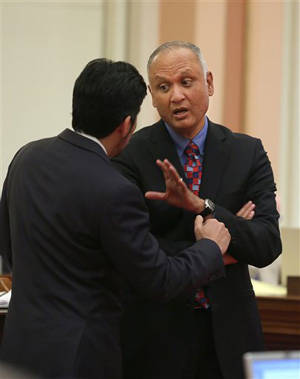Sen. Ed Hernandez, D-Covina, right, talks with Sen. Kevin de Leon, D-Los Angeles at the Capitol in Sacramento, Calif., Monday, April 21, 2014. Hernandez's proposal sailed through the state Senate in January on a Democratic Party-line vote. Legislative leaders, however, pulled the bill before it could be debated in the Assembly after the harsh reaction.