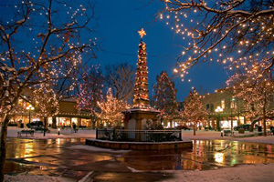 This undated image provided by New Mexico Tourism shows the historic plaza in Santa Fe, N.M., lit up for Christmas. A blend of Spanish, Anglo and Native traditions mark the holiday season in New Mexico.