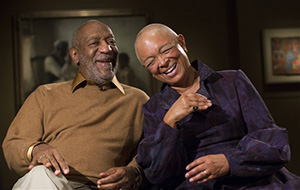 In this photo taken Nov. 6, 2014, entertainer Bill Cosby and his wife Camille share a laugh as they tell a story about collecting one of the pieces in the upcoming exhibit, Conversations: African and African-American Artworks in Dialogue, at the Smithsonian's National Museum of African Art in Washington.