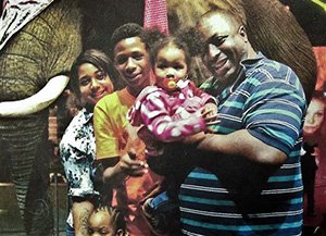In this undated family file photo provided by the National Action Network, Eric Garner, right, poses with his children during a family outing. According to a lawyer for the victim's family, a New York City grand jury on Wednesday, Dec. 3, 2014 cleared a white police officer in the videotaped chokehold death of the unarmed Garner, who had been stopped on suspicion of selling loose, untaxed cigarettes.