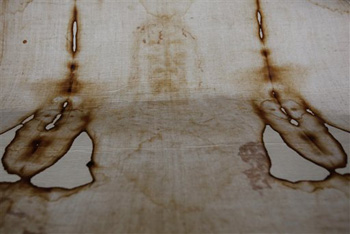 This Thursday, Sept. 30, 2010 file photo shows a replica of the Shroud of Turin, which some believe is Jesus Christ's burial cloth, at a church in Beirut, Lebanon. The cloth bears the figure of a crucified man, complete with blood seeping from his hands and feet, and believers say Christ's image was recorded on the linen's fibers at the time of his resurrection.
