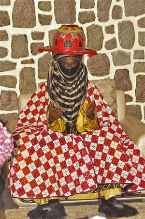 Traditional ruler Lamido Sanusi takes part in a prayer meeting Wednesday, June 11, 2014, at Kano State Government house in Kano, Nigeria. Lamido Sanusi was appointed on Sunday, June 8, 2014, as the new emir of Kano, replacing Emir Ado Bayero who died at age 83.