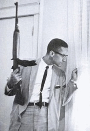 The photo of Malcolm X holding the rifle was taken when he was trying to protect his family from death threats (his home had been firebombed).