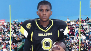 Trayvon Martin wearing his high school football jersey