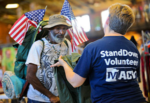 volunteer assisting a homeless veteran