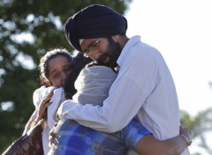 Sikh's console each other after shooting.