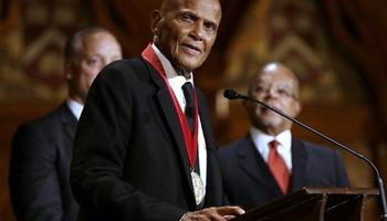 Artist and activist Harry Belafonte addresses an audience after accepting the W.E.B. Du Bois medal during ceremonies, Tuesday, Sept. 30, 2014, on the campus of Harvard University, in Cambridge, Mass. The Du Bois Medal is Harvard's highest honor in the field of African and African American Studies.