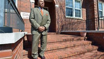 "St. Paul's College President Millard ""Pete"" Stith stands outside one of the 35 buildings for sale on the Lawrenceville, Va., campus of the historically black college and university on March 26, 2014. The college closed in 2013 under mounting debt and a loss of accreditation. Smith and St. Paul's alumni are hopeful an April 9 sale will resurrect the school, founded in 1888."