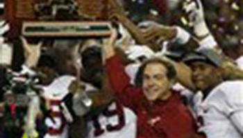Alabama head coach Nick Saban and players celebrate after the second half of the Southeastern Conference championship NCAA college football game against Missouri, Saturday, Dec. 6, 2014, in Atlanta. Alabama won 42-13.