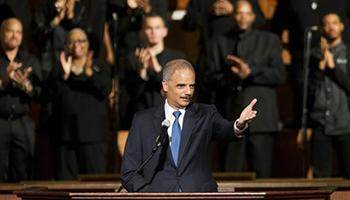 U.S. Attorney General Eric Holder gestures as he speaks to members of the community during an interfaith service at Ebenezer Baptist Church, the church where The Rev. Martin Luther King Jr. preached, Monday, Dec. 1, 2014, in Atlanta. Holder traveled to Atlanta to meet with law enforcement and community leaders for the first in a series of regional meetings around the country. The president asked Holder to set up the meetings in the wake of clashes between protesters and police in Ferguson, Missouri.