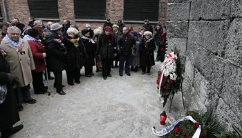 Auschwitz survivors lay a wreath at the former Nazi death camp Wall of Death in Oswiecim, Poland, on Monday, Jan. 27, 2014, to mark 69 years since the Soviet Red Army liberated the camp. Israeli lawmakers and government officials are to attend anniversary observances later in the day. The Nazis killed some 1.5 million people, mostly Jews at the camp during World War II.