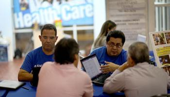 Hispanics account for about one-third of the nation's uninsured, but they seem to be staying on the sidelines as the White House races to meet a goal of 6 million sign-ups by March 31.