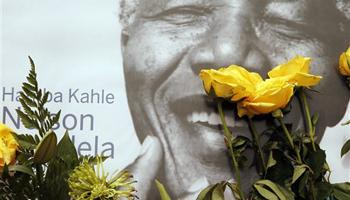 A portrait former president Nelson Mandela, placed outside his residence in Johannesburg, South Africa, Monday, Dec. 9, 2013. Mandela died Thursday Dec. 5 at his Johannesburg home after a long illness. He was 95.