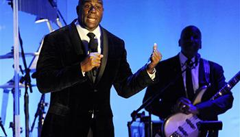 "In this Oct. 11, 2014, file photo, Earvin ""Magic"" Johnson addresses the audience after receiving the Brass Ring Award for his humanitarian efforts at the 2014 Carousel of Hope Ball at the Beverly Hilton Hotel in Beverly Hills, Calif. Now, as an entrepreneur focused on minority markets, he says he is ready to help Silicon Valley hire more blacks and Latinos to diversify the technology industry's largely white and Asian workforce."