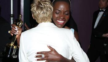 "Ellen DeGeneres, left, embraces Lupita Nyong'o backstage after she won best supporting actress for ""12 Years a Slave"" during the Oscars at the Dolby Theatre on Sunday, March 2, 2014, in Los Angeles."