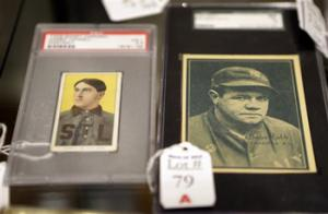 In this photo made Tuesday, March 11, 2014, baseball cards of major leaguers Harry Howell, left, and Babe Ruth are seen at the Saco River Auction House in Biddeford, Maine. The auction house is getting a reputation for selling some of the nation's oldest baseball memorabilia.