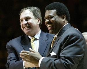 "In this Feb. 13, 2007 file photo, former Tennessee basketball players Bernard King, right, and Ernie Grunfeld, laugh during a ceremony to retire King's #53 jersey during halftime of the Tennessee-Kentucky game in Knoxville, Tenn. In an ESPN ""30 For 30"" documentary airing Tuesday, Nov. 5, 2013, about the friendship between King and Grunfeld, King publicly discusses for the first time incidents of racism he says he encountered while in college."