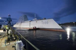 In this image provided by the U.S. Navy the Zumwalt-class guided-missile destroyer DDG 1000 is floated out of dry dock at the General Dynamics Bath Iron Works shipyard Oct. 28, 2013. The ship that bears his name, the first of three Zumwalt-class destroyers, was christened by Zumwalt's two daughters on Saturday April 12, 2014 at Bath Iron Works.