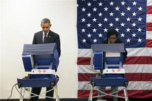In this Oct. 20, 2104 file photo, President Barack Obama votes early for the midterm election at the Dr. Martin Luther King Community Service Center in Chicago. President Barack Obama is hitting the black radio airwaves to plead for midterm votes.