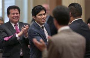 Senator Kevin de Leon, Democrat from Los Angeles, second from left, receives congratulations from other lawmakers after he was elected as the new Senate President Pro Tem at the Capitol in Sacramento, Calif., Monday, June 16, 2014. De Leon will become just the second Latino leader of the Senate, but the first in more than 130 years.