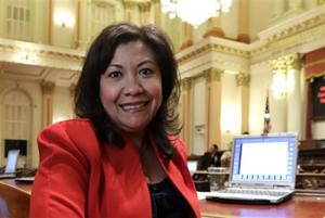 "In this Aug. 28, 2014 file photo, California state Sen. Norma Torres, D-Pomona, poses in the Senate Chambers at the Capitol in Sacramento. Torres, a first-time candidate for Congress, tells voters there is no more critical time to vote than now _ even as she accepts that ""great disillusion"" might prompt many Hispanic voters to sit this non-presidential midterm election out."
