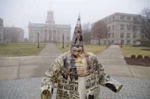 This KKK statue as an art form was displayed on the campus of the University of Iowa by a visiting professor and incited a strong reaction from black students.