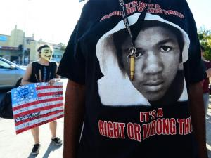 "protests Trayvon Martin t-shirt and ""Anonymous"" mask"