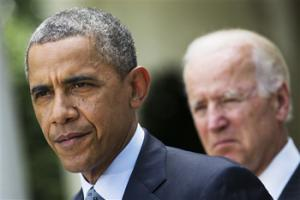 In this June 30, 2014, file photo, President Barack Obama, accompanied by Vice President Joe Biden, pauses while making a statement about immigration reform, in the Rose Garden of the White House in Washington. Obama over time has been embraced and scorned by immigrant advocates who have viewed him as both a champion and an obstacle to their cause.