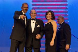 President Barack Obama, left, points toward a camera with chairman of the Congressional Hispanic Caucus Rep. Ruben Hinojosa, D-Texas, Marty Hinojosa, and Sen. Bob Menendez, D-N.J., at the Congressional Hispanic Caucus Institute's 37th Annual Awards Gala at the Walter E. Washington Convention Center in Washington, Thursday, Oct. 2, 2014.