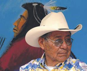 Native American man wearing cowboy hat