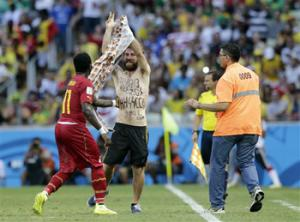 The man who invaded the pitch during the Germany-Ghana match at the World Cup was a neo-Nazi sympathizer, according to a report that will be delivered to FIFA on Monday.